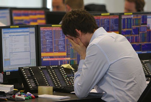 Frustrated trader covered his face with his hands