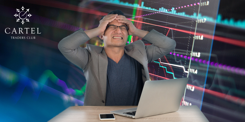 Trader holding his head